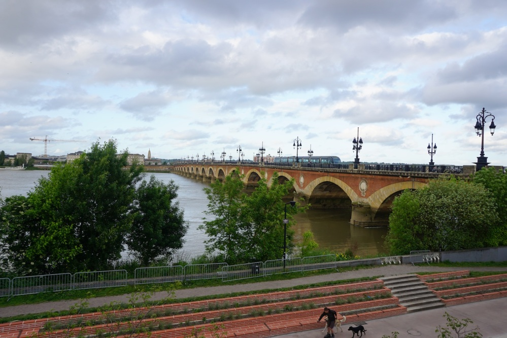 Pont de pierre or in english Stone Bridge crossing the Garonne river